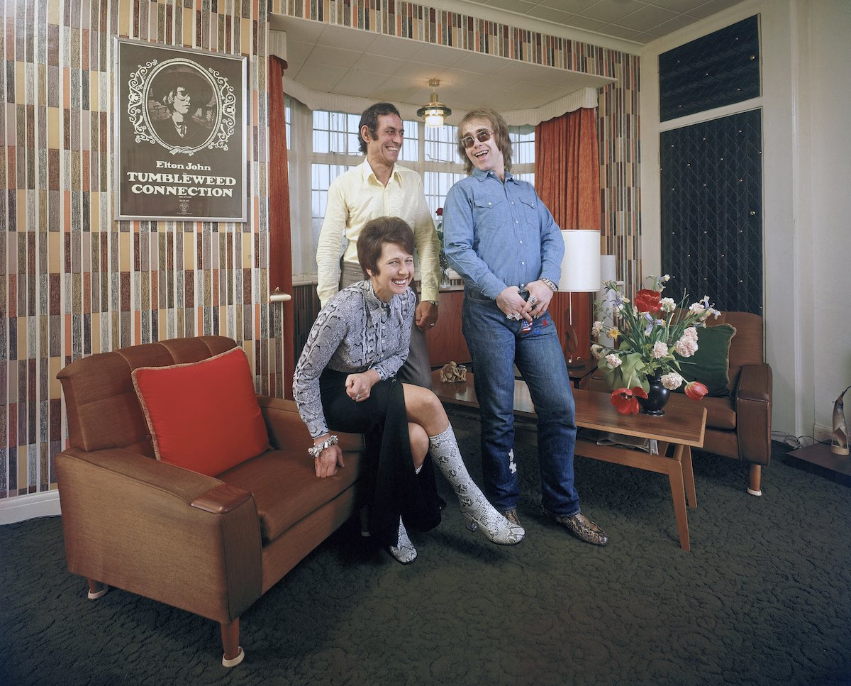 Rock musician Elton John (R) sharing a laugh w. his mother Shelia (L) and stepfather Fred Fairebrother (C) in their apartment.